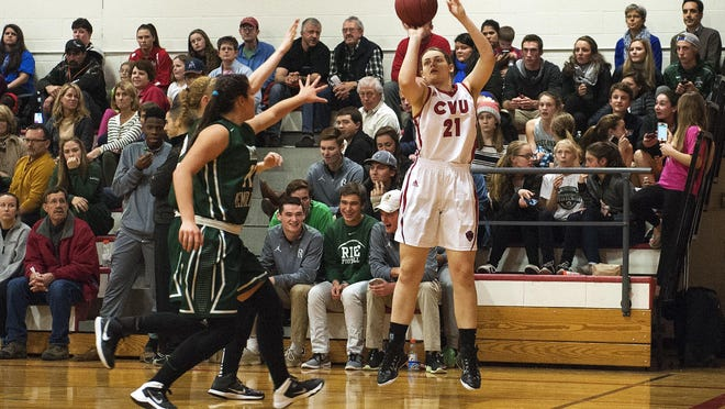 CVU's Abby Thut (21) takes a 3-point shot during a high school girls basketball game last season.