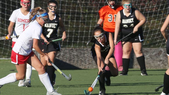 Nanuet's Maddy D'Amelio (2) clears the ball away from