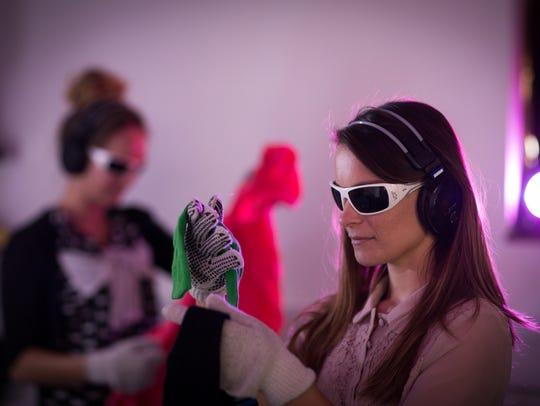 A woman experiences the Virtual Dementia Tour.