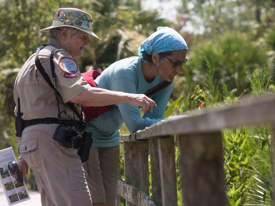 The Audubon Corkscrew Swamp Sanctuary offers guided walks on Corkscrew's boardwalk to learn and experience the western Everglades. Joan Dunn, left, teaches Dorine Demena how to identify and differentiate commonly seen species on Thursday, July 26, 2018. Volunteers as part of the 20th annual North American Butterfly Association Summer Count teamed up in an effort to record all the butterflies seen during the walk, although the effects of Hurricane Irma meant lower butterfly counts than in years past.
