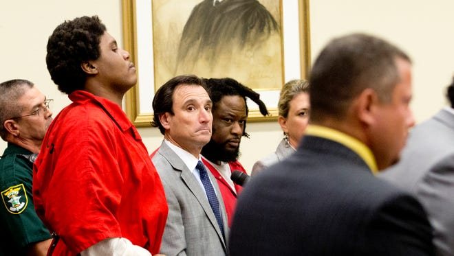 Terrance Irons,  second from left, and Thomas Edison, fourth from left, attend a hearing for Cashae Smith, right, to quash a writ of bodily attachment.  Police say Cashae was witness to the murder of Andrew Faust.  Smith was in court with her lawyers after refusing show up after being subpeonad numerous times.