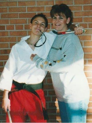 Alex McLellan and his mother, Anna Casper, enjoy a lighthearted moment at Fond du Lac High School, where Alex attended until his 2003 suicide.