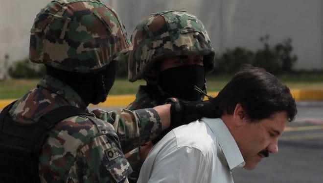 "Joaquin "" El Chapo"" Guzman in custody in Mexico City on Saturday."