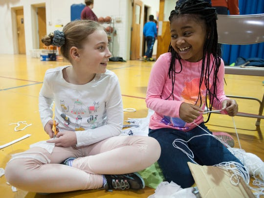 Friends School Mullica Hill students, Dealia Owens, left, and Neah Ellis share a laugh as the work together on a craft donation project in honor of Martin Luther King Jr. in 2017. Some local places plan community-service events in honor of MLK Day on Monday.