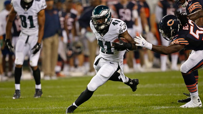 Philadelphia Eagles running back David Fluellen (41) carries the ball against Chicago Bears defense in the second half of an NFL preseason football game Friday, Aug. 8, 2014, in Chicago. (AP Photo/Charles Rex Arbogast)