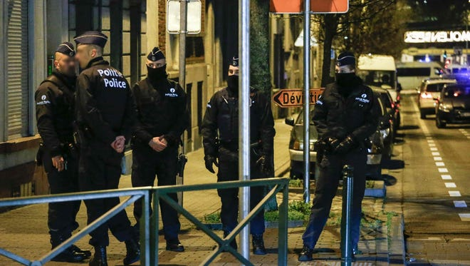 Police officers conduct new searches linked to Paris terrorist attacks, on December 30, 2015, in Molenbeek, Brussels.
