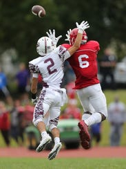 Scarsdale's Andrew Gindi, 2, knocks away a pass intended