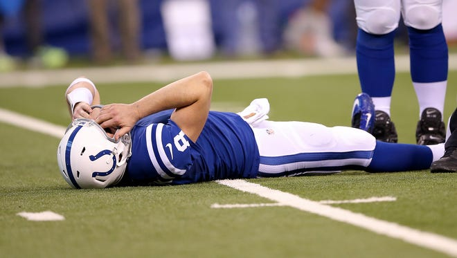 Indianapolis Colts quarterback Matt Hasselbeck (8) lays on the turf after getting hit in the fourth quarter. The Indianapolis Colts lost to the Houston Texans 10-16 Sunday, December 20, 2015, afternoon at Lucas Oil Stadium.