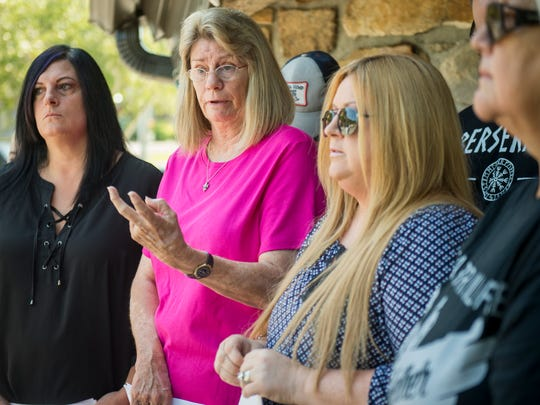 Genie Brabham, second from left, speaks before the Gatlinburg Wildfire Survivors group handed in questions to the city commission at Gatlinburg City Hall on Wednesday, July 12, 2017.