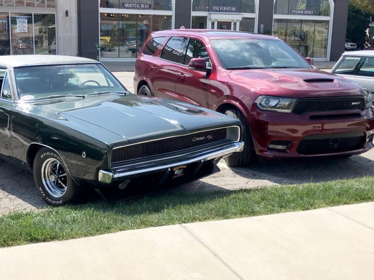 Dodge performance, yesterday and today: a 1968 Charger and 2018 Dodge Durango SRT on Old Woodward Ave in Birmingham on August 16, 2017.