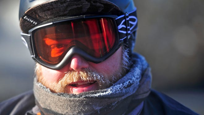 Michael Harley rides his bicycle to work in the frigid weather on Berry Road in Nashville, Tenn., Thursday, Jan. 8, 2015.