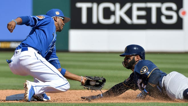 Royals shortstop Alcides Escobar tags out Jonathan Villar trying to steal second in the third inning Saturday.