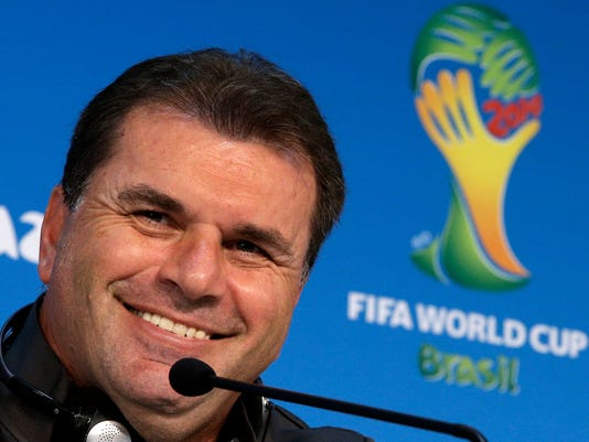 Australia's head coach Ange Postecoglou smiles during a press conference the day before the group B World Cup soccer match between Chile and Australia in the Arena Pantanal in Cuiaba, Brazil, Thursday, June 12, 2014. (AP Photo/Michael Sohn)