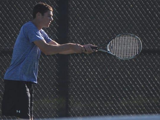 Centerville's Skyler Benedict returns a shot Monday