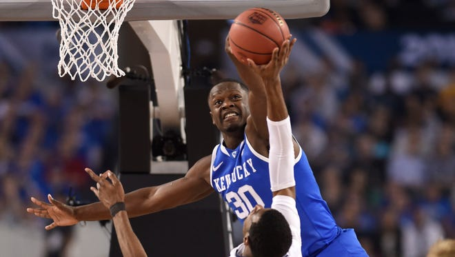 Kentucky forward Julius Randle (30) blocks the shot of Connecticut forward DeAndre Daniels (2) in the first half of the NCAA men's basketball championship on Monday in Arlington, Texas. Randle is a projected top-five pick in the June NBA draft.