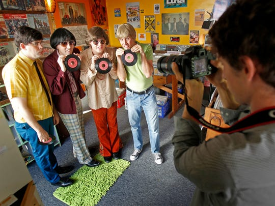 """Cast members Kyle More, from left, Matt Cook, Matt Shively and Josh Duvendeck pose for stills with photographer Julien Lasseur while filming """"Bucky and the Squirrels"""" in Appleton in September 2013."""