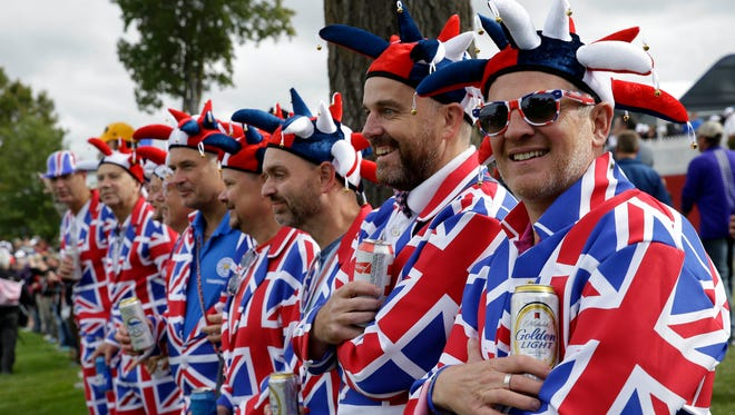 Sep 28, 2016; Chaska, MN, USA; Fans dressed up in British flag suits watch the action during the practice round for the Ryder Cup at Hazeltine National Golf Club. Mandatory Credit: Rob Schumacher-USA TODAY Sports ORG XMIT: USATSI-326254 ORIG FILE ID:  20160928_jfv_usa_084.jpg