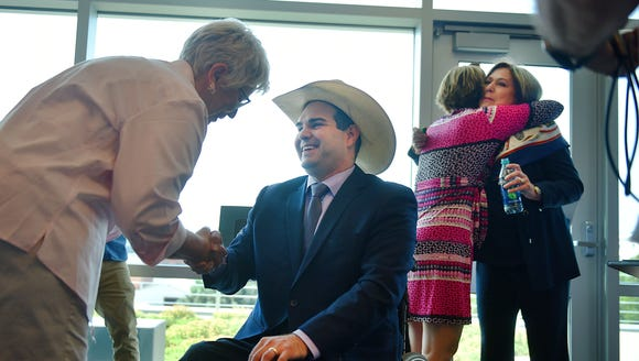 Billie Sutton shakes Betty DeBerg's hand, left, and
