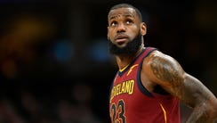 Cleveland Cavaliers forward LeBron James reacts in