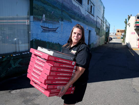 Angelique Easton, a line cook at Westside Pizza, delivers