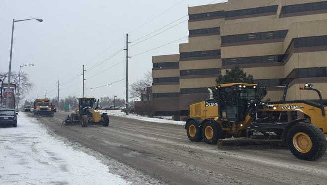 Plows roll past Avera McKennan Hospital on South Cliff Avenue on Wednesday.