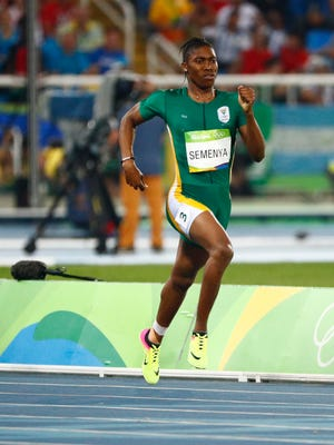 Caster Semenya of South Africa claims gold in the women's 800.