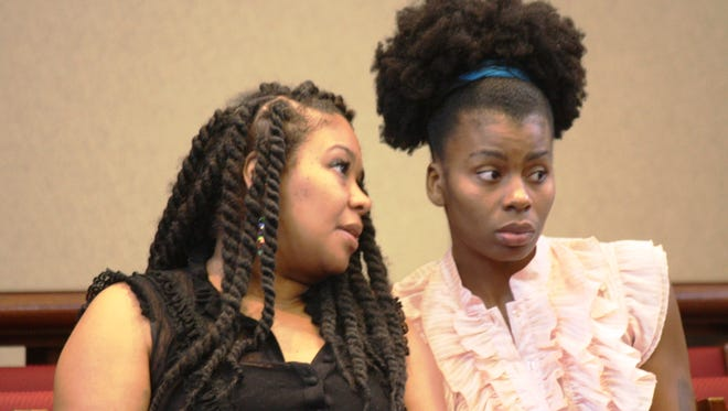 Sisters Krystal Dixon, left, and Maya Dixon in Fairfield Municipal Court for a recent hearing. They are charged with resisting arrest and disorderly conduct after an altercation with Fairfield police outside a municipal pool in June.