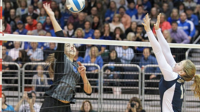 Charley Andrews of Harper Creek goes for the kill in the Class B state semifinal against Lake Odessa at Kellogg Arena on Thursday.