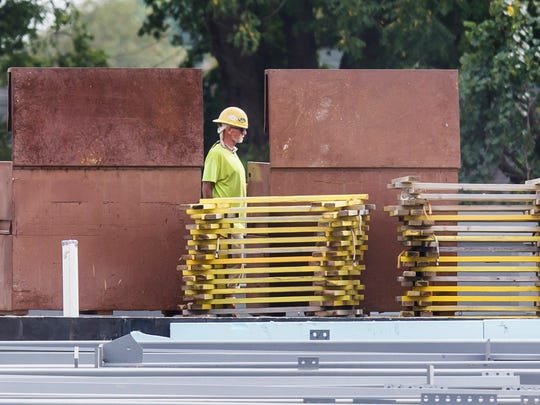 A worker walks through the construction site of the new library being built off of Del. 9 near Wilmington on Tuesday afternoon. A bill to require local workers and veterans on New Castle County-funded construction projects costing more than $5 million has been withdrawn.