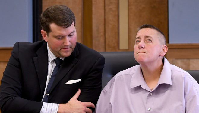 Joyell Riley is shown with attorney Adam Stone at her change-of-plea hearing.