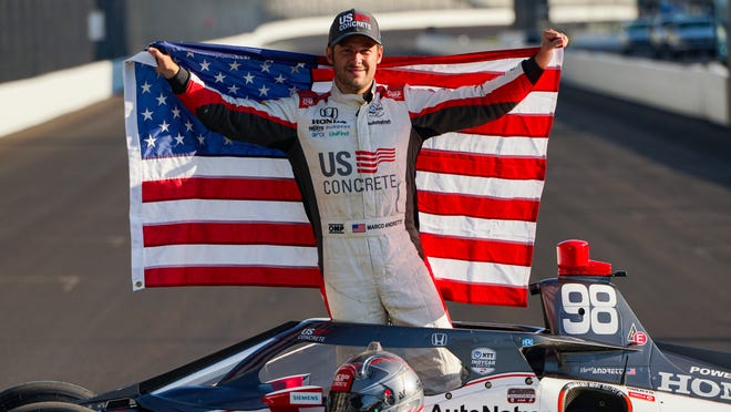 Marco Andretti poses atop his car with the American flag earlier this week. He is the polesitter for Sunday's Indianapolis 500 in Indiana.
