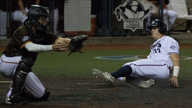 First baseman Andrew Czech slides into home, scoring for the Chillicothe Paints against the Kokomo Jackrabbits at V.A. Memorial Stadium in Chillicothe Monday night.