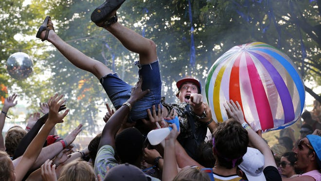 Scott Utterback/The Courier-Journal A record crowd of more than 65,000 people came out to the Forecastle Festival. Crowd surfing in Party Cove at Forecastle. July 17, 2016