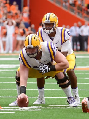 LSU Tigers quarterback Brandon Harris (6) under center Ethan Pocic (77) during the first quarter in a game against the Syracuse Orange at the Carrier Dome.