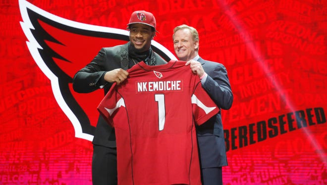 Robert Nkemdiche from Ole Miss poses with NFL commissioner Roger Goodell after being selected by the Arizona Cardinals as the 29th pick in the NFL draft on Thursday, April 28, 2016, in Chicago.