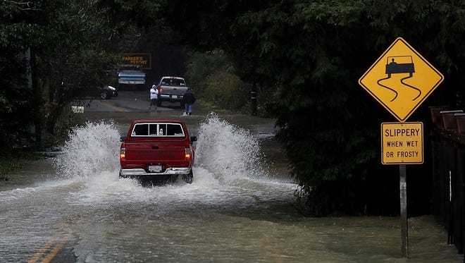 A truck drives on a flooded street on January 10, 2017 in Guerneville, California.