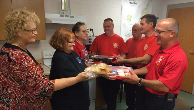Members of the Crossroads Church of Sturgeon Bay organized lunches for Sturgeon Bay firefighters and paramedics on Friday, in appreciation for their life-saving and dangerous work. From left, Crossroads members Darlene Peters, Deb Ellis and Dave Peters hand food to Sturgeon Bay Fire Chief Tim Herlache, Mike Smith, Lt. Dick Stuewer and Mark Smith.