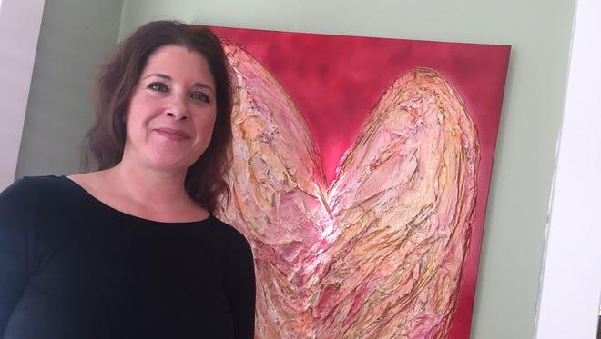 Kathleen Doherty, of Binghamton, paints papier-mache art.