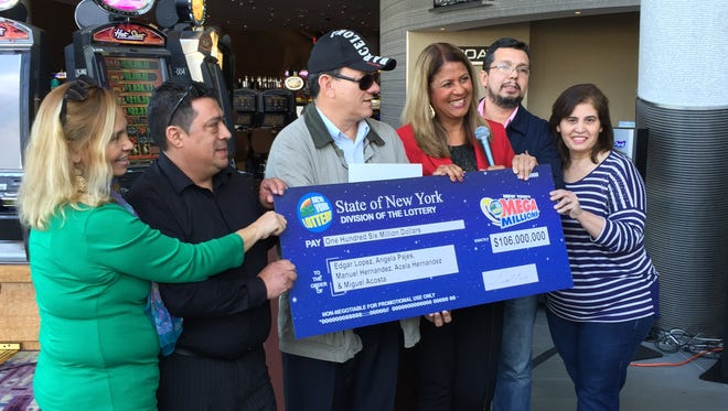 Winners of a $106 Mega Millions jackpot pose at Empire City Casino in Yonkers, Oct. 29, 2015. From left: Acela Hernandez, her husband, Manuel Hernandez, Edgar Lopez, all of Yonkers, the Lottery's Yolanda Vega, Miguel Acosta of Yonkers and Angela Pajes of Basking Ridge, New Jersey.