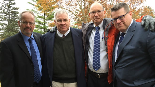 The four Bodette brothers gather at their mother's grave Oct. 31 in Southfield, Michigan. From left: Phil, Charlie, John and David.
