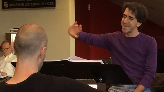 """Composer Jason Robert Brown conducts an orchestra rehearsal Tuesday in the Des Moines Civic Center lobby for """"The Bridges of Madison County,"""" which launches its national tour this weekend."""