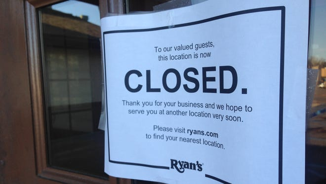A sign announces the closing of Ryan's in Pineville.