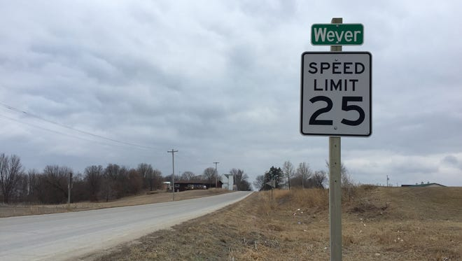 The one main road that runs through Wever, the old Highway 61, is maintained by the county, since the town isn't even incorporated.