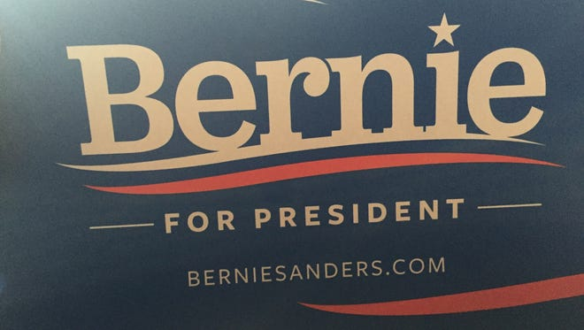 """""""Bernie for President"""" signs were handed out Monday night at Democratic National Convention."""