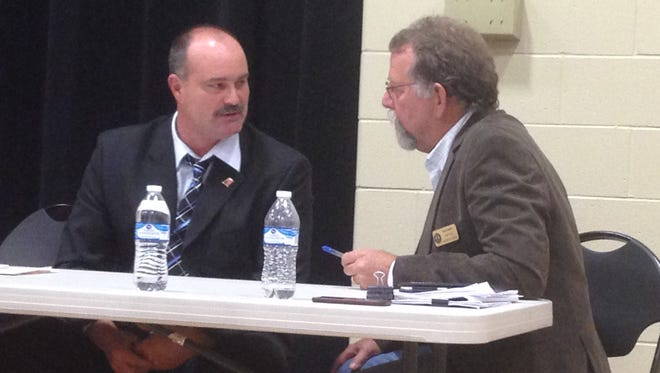 Kevin Curtis (left) and Rick Hamill chat during Monday night's candidate forum in Highland. Both are seeking the township supervisor position.