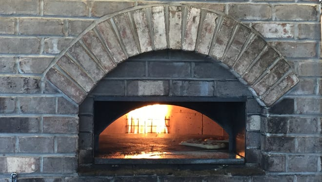Pizzas cooking in the oven at Pi Craft Pizza in Henrietta.