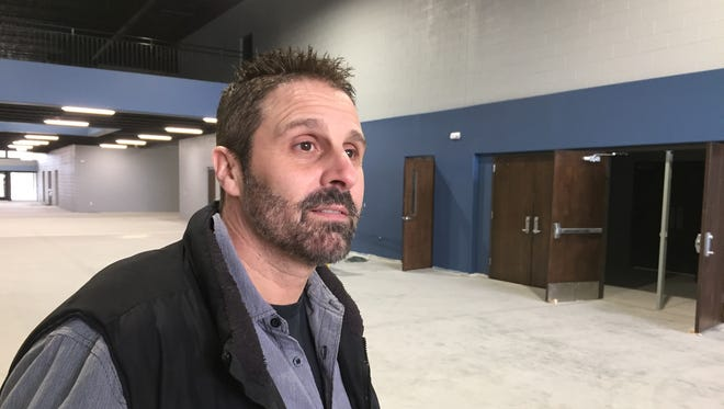 Pastor Angelo Fleece of Rock Church looks around the commons area of the church's new 70,000-square-foot addition.