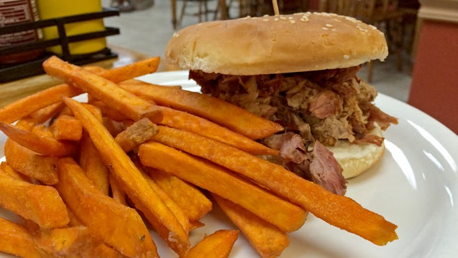 The Smoked Pulled Pork Sandwich is one of the barbecue options at Papa Gus Restaurant in Leeds.