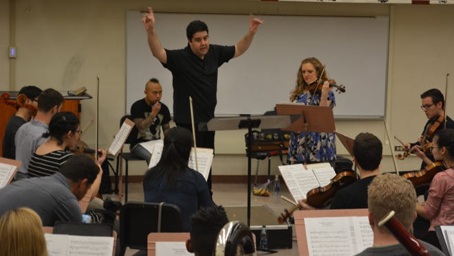 "Phoenix Symphony maestro Tito Munoz conducts the ASU Symphony Orchestra in a run-through of ""Dependent Arising"" by composer Earl Maneein (with the mohawk) and violinist Rachel Barton Pine."