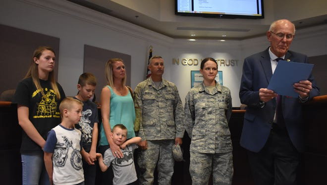 Mayor Richard Boss reads a proclamation honoring military children in front of the Blantons, a local military family. Senior Master Sgt. Kevin Blanton and his wife, retired First Sgt. Brooke Blanton, have both served the Air Force for over 20 years while raising four children.